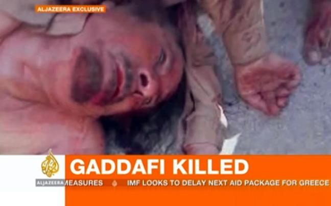 http://www.newsbeast.gr/files/1/2011/10/20/gaddafi.jpg
