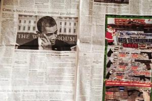 Διαφήμιση με όπλα δίπλα στην είδηση του μακελειού στο Κονέκτικατ!