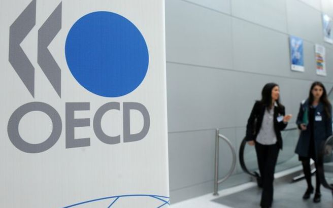 Ψαλίδισε» τις προβλέψεις για την ανάπτυξη της παγκόσμιας οικονομίας ο ΟΟΣΑ