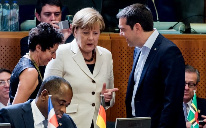 Greek Prime Minister Alexis Tsipras, second right, speaks with German Chancellor Angela Merkel during a round table meeting at the EU-CELAC summit in Brussels on Wednesday, June 10, 2015. Greece's prime minister was hoping to meet with the leaders of Germany and France in Brussels Wednesday, in the latest effort to break a bailout negotiation deadlock that has revived fears his country could default and drop out of the euro. (AP Photo/Geert Vanden Wijngaert)