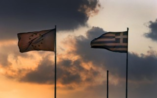 "A European Union flag flatters next to a Greek flag atop the Greek Ministry of Finance during sunset in central Athens, Greece June 5, 2015. Greece's government rejects an ""absurd"" and ""unrealistic"" proposal from creditors and hopes it will be withdrawn, Prime Minister Alexis Tsipras said on Friday as he called on lenders to accept a rival proposal from Athens instead. REUTERS/Yannis Behrakis"