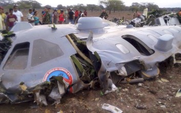 """Debris of a crashed transport plane of Colombian Air Force is seen near the town of Codazzi, about 600 kilometers (372 miles) northeast of Bogota, Colombia, near the border with Venezuela July 31, 2015. Eleven Colombian military personnel were killed on Friday when their transport plane suffered motor failure and crashed in the northern province of Cesar, killing all on board, according to a statement from the Air Force. The burned hulk of the plane was found near Codazzi. President Juan Manuel Santos called the victims """"heroes"""" in a Tweet. REUTERS/Colombian Air Force/Handout via Reuters ATTENTION EDITORS - THIS PICTURE WAS PROVIDED BY A THIRD PARTY. REUTERS IS UNABLE TO INDEPENDENTLY VERIFY THE AUTHENTICITY, CONTENT, LOCATION OR DATE OF THIS IMAGE. FOR EDITORIAL USE ONLY. NOT FOR SALE FOR MARKETING OR ADVERTISING CAMPAIGNS. THIS PICTURE IS DISTRIBUTED EXACTLY AS RECEIVED BY REUTERS, AS A SERVICE TO CLIENTS."""