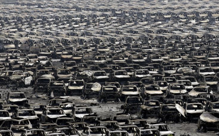 Damaged cars are seen near the site of the explosions at the Binhai new district, Tianjin, August 13, 2015. At least 17 people were killed and 400 injured when two huge explosions tore through an industrial area where toxic chemicals and gas were stored in the northeast Chinese port city of Tianjin, state media said on Thursday. REUTERS/Jason Lee