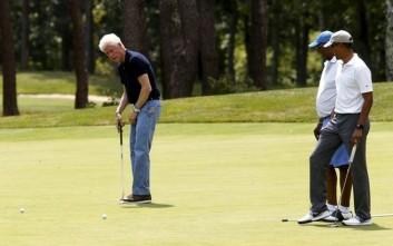 Ομπάμα και Κλίντον έπιασαν τα μπαστούνια