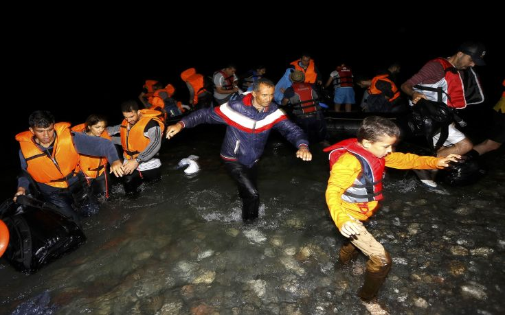 "Syrian refugees jump off a dinghy as they arrive at a beach on the Greek island of Kos after crossing a part of the Aegean sea from Turkey to Greece on a dinghy August 13, 2015. The United Nations refugee agency (UNHCR) called on Greece to take control of the ""total chaos"" on Mediterranean islands, where thousands of migrants have landed. About 124,000 have arrived this year by sea, many via Turkey, according to Vincent Cochetel, UNHCR director for Europe. REUTERS/Yannis Behrakis"