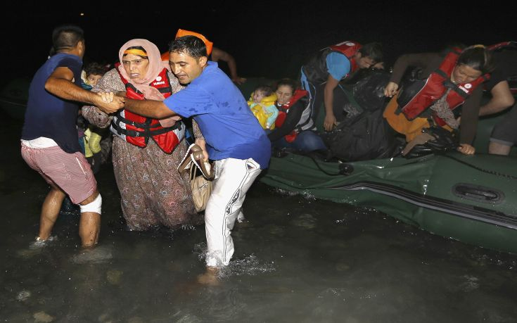 "Syrian refugees arrive at a beach on the Greek island of Kos after crossing a part of the Aegean sea from Turkey to Greece on a dinghy August 13, 2015. The United Nations refugee agency (UNHCR) called on Greece to take control of the ""total chaos"" on Mediterranean islands, where thousands of migrants have landed. About 124,000 have arrived this year by sea, many via Turkey, according to Vincent Cochetel, UNHCR director for Europe. REUTERS/Yannis Behrakis"