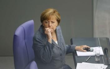 Την κατιούσα πήρε η δημοτικότητα της Μέρκελ εξαιτίας της ελληνικής συμφωνίας