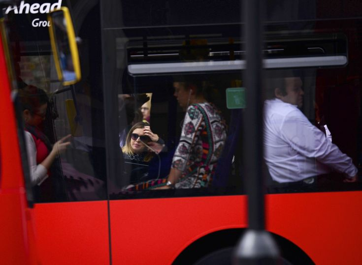 Commuters sit in a bus outside Waterloo Station in London, Britain August 6, 2015. Millions of Londoners struggled to work on Thursday as a strike brought the Underground rail network to a standstill for the second time in a month over plans for a new all-night service.  REUTERS/Dylan Martinez