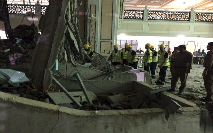 Members of a Saudi emergency crew stand near damage caused by a collapsed crane in the Grand Mosque in the Muslim holy city of Mecca, Saudi Arabia in this handout picture published on Twitter account of the Directorate of the Saudi Civil Defense September 11, 2015. At least 107 people were killed when the crane toppled over at Mecca's Grand Mosque on Friday, Saudi Arabia's Civil Defence authority said, less than two weeks before Islam's annual haj pilgrimage. REUTERS/Directorate of the Saudi Civil Defense/Handout via ReutersATTENTION EDITORS - THIS IMAGE HAS BEEN SUPPLIED BY A THIRD PARTY. IT IS DISTRIBUTED, EXACTLY AS RECEIVED BY REUTERS, AS A SERVICE TO CLIENTS. REUTERS IS UNABLE TO INDEPENDENTLY VERIFY THE AUTHENTICITY, CONTENT, LOCATION OR DATE OF THIS IMAGE. FOR EDITORIAL USE ONLY. NOT FOR SALE FOR MARKETING OR ADVERTISING CAMPAIGNS. NO SALES.