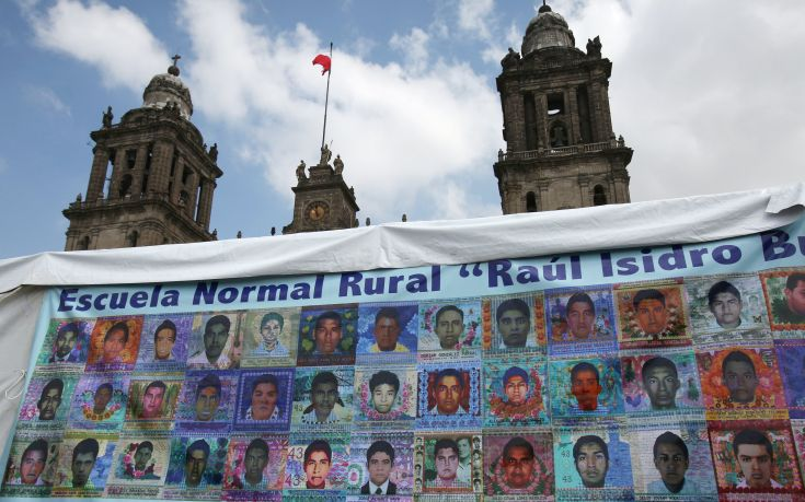 Pictures of some of the 43 missing students of Ayotzinapa College Raul Isidro Burgos are seen on a banner as relatives (not pictured) attend a news conference after completing a hunger strike of 48 hours, ahead of the first anniversary of the students' disappearance, at Zocalo Square in downtown Mexico City, Mexico September 25, 2015. Parents of 43 Mexican students kidnapped and apparently massacred a year ago demanded a new probe into their fate on Thursday, accusing President Enrique Pena Nieto of ignoring their demands to solve a crime that has battered Mexico's image. The families asked the government to launch a new internationally supervised investigation and to review Mexico's own investigators, after international experts cast doubt on Mexico's official account of the incident. The Metropolitan Cathedral is pictured in the background. REUTERS/Ginnette Riquelme