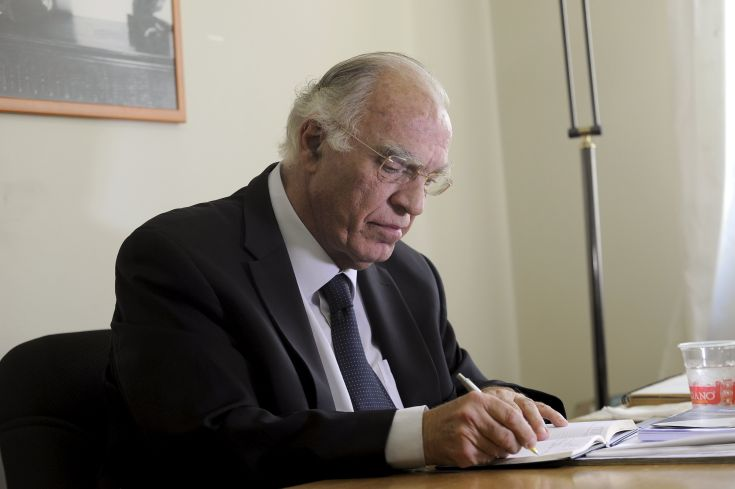 Leader of the Union of Centrists party Vassilis Leventis takes notes before an interview with Reuters at the party headquarters in Athens, Greece, September 17, 2015. A civil engineer and one-time aspiring musician who claims to have had the foresight to predict Greece's financial crisis 25 years ago is making a dent in mainstream parties' support before national elections. Tapping into frustration at years of economic hardship and broken promises, Vassilis Leventis's Union of Centrists is polling between 3.5 and 4 percent of the electorate, giving it a foothold to win seats in Greece's 300-member parliament in Sunday's vote. REUTERS/Michalis Karagiannis