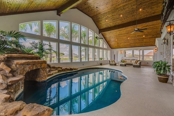 as-you-pass-the-lagoon-style-indoor-pool-a-staircase-beams-you-right-into