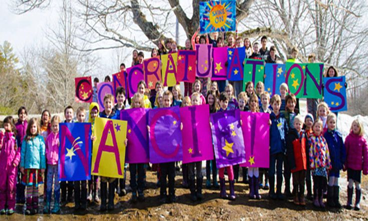 NOT TO ARCHIVE NOT TO ARCHIVE NOT TO ARCHIVE_Center for Teaching and Learning students proudly hold up homemade signs Monday, March 16 congratulating school founder Nancie Atwell for winning the Global Teacher Prize. (Photo courtesy Center for Teaching and Learning)