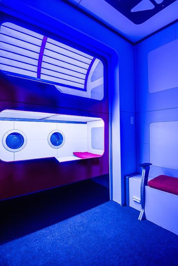 blue-lighting-brings-the-sci-fi-experience-home-especially-in-the-pod-style-bunk-beds