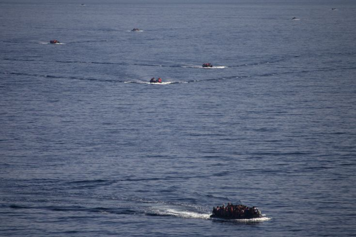 Refugees and migrants are seen onboard eight dinghies as they cross a part of the Aegean Sea from the Turkish coast to reach the Greek island of Lesbos, October 4, 2015. Refugee and migrant arrivals to Greece this year will soon reach 400,000, according to the UN Refugee Agency (UNHCR). REUTERS/Dimitris Michalakis