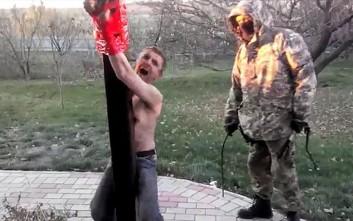 Σκληρό βίντεο με μαχητές να μαστιγώνουν κατηγορούμενο για ναρκωτικά στην Ουκρανία