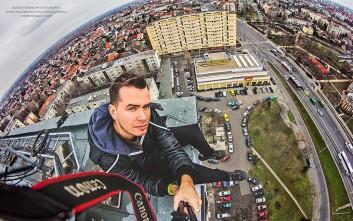 Σκαρφαλώνει σε ψηλά μνημεία και κτίρια για να απαθανατίσει τη Βουδαπέστη