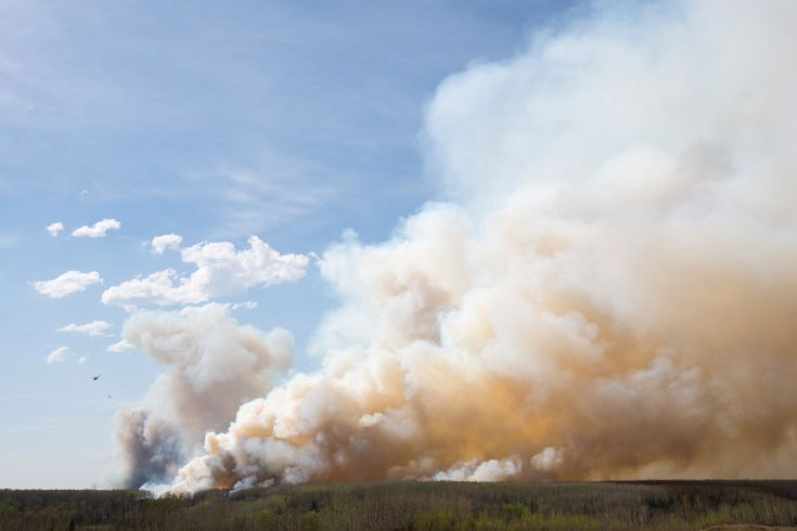 2016-05-04T213104Z_354966983_S1BETCEFWIAB_RTRMADP_3_CANADA-WILDFIRE-FORTMCMURRAY