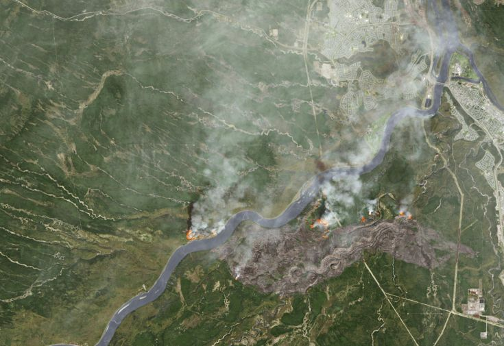 2016-05-04T215554Z_851003216_TM3EC541DLG01_RTRMADP_3_CANADA-WILDFIRE-FORTMCMURRAY