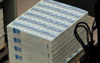 Bloomberg: Εγκρίθηκε η εκταμίευση στην Ελλάδα της δόσης των 748 εκατ. ευρώ από το Eurogroup
