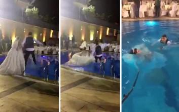 Να τι συμβαίνει όταν πηδάς στην πισίνα με ένα βαρύ νυφικό