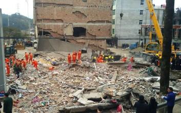Εννέα άτομα έχουν θαφτεί ζωντανά σε χαλάσματα πολυκατοικιών στην Κίνα