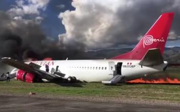 Τρόμος σε αεροσκάφος που έπιασε φωτιά κατά τη διάρκεια αναγκαστικής προσγείωσης