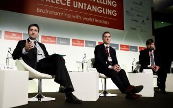 Κόντρα Χουλιαράκη με εκπρόσωπο της ΕΚΤ για το QE και το χρέος