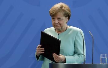 Μέρκελ: Ιστορική η συμφωνία του Παρισιού για το κλίμα, δεν μπορούμε να κάνουμε πίσω