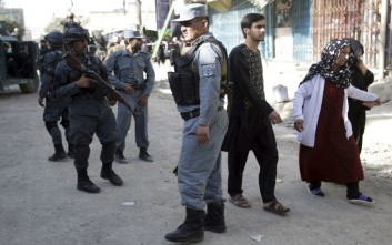 Women leave the site of a suicide attack outside a Shiite mosque in Kabul, Afghanistan, Friday, Sept. 29, 2017. A suicide bomber blew himself up outside a Shiite mosque in the Afghan capital Kabul on Friday, killing four people and wounding 20 others, authorities said. (AP Photo/Massoud Hossaini)