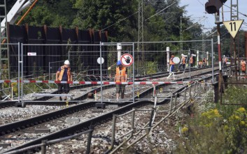 In this Aug. 21, 2017 photo the tunnel construction site where railway tracks have subsided, in Rastatt  Germany, is photographed.  Germany's national railway says Tuesday, Aug. 22, 2017  that part of a busy route connecting Germany and Switzerland is expected to remain closed until Oct. 7 after tracks above a tunnel that was under construction sagged. Deutsche Bahn halted trains between Rastatt and Baden-Baden in southwestern Germany following the incident on Aug. 12. Since then, travelers from Berlin, Hamburg and Frankfurt to Basel and Zurich have had to change on to buses for that short stretch, lengthening journey times. (Uli Deck/dpa via AP)