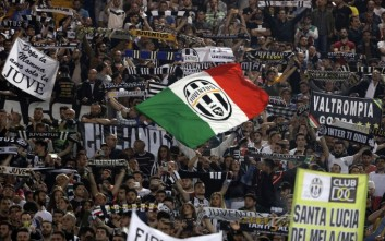 Juventus fans cheer during a Serie A soccer match between Roma and Juventus, at Rome's Olympic stadium, Sunday, May 14, 2017. (AP Photo/Gregorio Borgia)