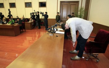 American student Otto Warmbier, right, bows as Warmbier is presented to the reporters on Monday, Feb. 29, 2016, in Pyongyang, North Korea. North Korea announced late last month that it had arrested the 21-year-old University of Virginia undergraduate student. (AP Photo/Kim Kwang Hyon)