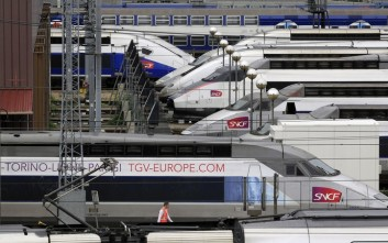 TGV high speed trains are parked near Gare de Lyon station in Paris, Thursday June 13, 2013, as French rail workers strike to protest a reorganization of the national rail and train companies. Up to 70 percent of train journeys in France will be canceled on Thursday. The action began Wednesday night, affecting overnight, international travel and ends Friday morning. (AP Photo/Remy de la Mauviniere)