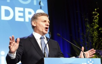 New Zealand's Prime Minister Bill English talks to hundreds of supporters after election results are announced on Saturday, Sept. 23, 2017, in Auckland, New Zealand. His National Party won the most votes of any party, although not enough to form a government without the support of minor parties which may take several days or weeks to negotiate. (AP Photo/Nick Perry)