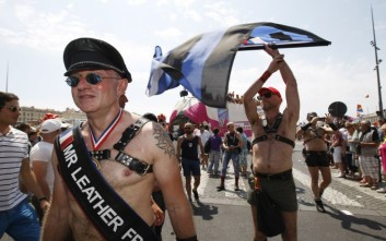 Demonstrators take part in the  Europride gay rights march 2013,  in Marseille, southern France, Saturday, July 20, 2013. . (AP Photo/Claude Paris)