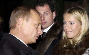 "FILE - In this Saturday, Nov. 29, 2003 file photo, Russian President Vladimir Putin, left, speaks with Lyudmila Narusova, right, widow of former St. Petersburg mayor Anatoly Sobchak, and Sobchak's daughter Ksenia, as he visited the grave of Anatoly Sobchak at a cemetery in St. Petersburg, Russia. Ksenia Sobchak, the 30-year-old blond socialite and TV personality said ""I'm Ksenia Sobchak, and I've got something to lose. But I'm here."" when she began her unlikely foray into political activism by taking the stage at a huge anti-Putin rally in December. Russian President Vladimir Putin. (Sputnik, Government Pool Photo via AP, file)"