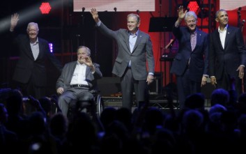 Former Presidents from right Barack Obama, Bill Clinton, George W. Bush, George H.W. Bush and Jimmy Carter wave on stage at the opening of a hurricanes relief concert in College Station, Texas, Saturday, Oct. 21, 2017. All five living former U.S. presidents joined to support a Texas concert raising money for relief efforts from Hurricane Harvey, Irma and Maria's devastation in Texas, Florida, Puerto Rico and the U.S. Virgin Islands. (AP Photo/LM Otero)