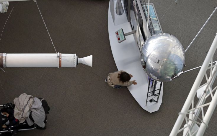 A child climbs below a Sputnik 1 test satellite, right, most likely manufactured by the Academy of Sciences of the USSR and one of only two known to exist, on display at the Museum of Flight, Monday, Oct. 2, 2017, in Seattle. At left is a full-size model of Explorer 1, a U.S. satellite developed in response to the Soviet satellite and launching the space race. Sixty years earlier, the Soviet Union launched Sputnik 1, the world's first artificial satellite, aboard an R-7 intercontinental ballistic missile on October 4, 1957. According to Soviet calculations, the satellite traveled at 18,000 miles per hour, and its radio signals were picked up by scientists and ham radio operators throughout the world. Sputnik 1 orbited about 37 million miles, then burned up as it fell from orbit during reentry into Earth's atmosphere on January 4, 1958. (AP Photo/Elaine Thompson)