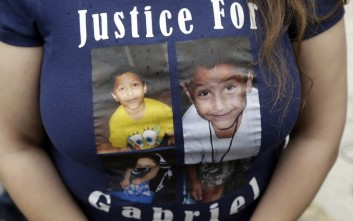 A friend of the family of Gabriel Fernandez, an 8-year-old boy who died in 2013, wears a shirt with his likeness at a news conference in the Sylmar district of Los Angeles, Thursday, April 7, 2016. Prosecutors charged four Los Angeles County social workers with child abuse, saying they were so negligent in handling the case of the young boy who died of gruesome, multiple injuries that, just like his abusers, they were criminally responsible. Gabriel's mother, Pearl Fernandez, and her boyfriend, Isauro Aguirre, have pleaded not guilty to murder and are in jail awaiting trial. (AP Photo/Nick Ut)