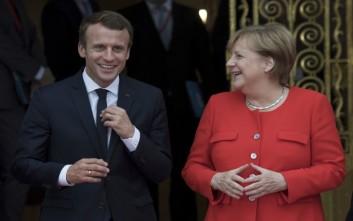 Νέα συνθήκη γαλλογερμανικής συνεργασίας υπογράφουν Μακρόν και Μέρκελ