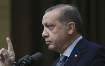 Turkey's President Recep Tayyip Erdogan addresses the local administrators at his presidential palace in Ankara, Turkey, Wednesday, Oct. 18, 2017. Erdogan says he holds the leadership of the Iraqi Kurdish region responsible for the bloodshed that ensued in the wake of last month's referendum for independence. (Presidential Press Service, pool via AP)