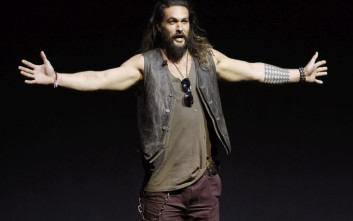 "Jason Momoa, a cast member in the upcoming films ""Justice League"" and ""Aquaman,"" addresses the audience during the Warner Bros. Pictures presentation at CinemaCon 2017 at Caesars Palace on Wednesday, March 29, 2017, in Las Vegas. (Photo by Chris Pizzello/Invision/AP)"