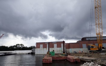 FILE -In this Thursday, Aug. 10, 2017 file photo, rain clouds gather over a pumping station at Marconi Drive and lake Pontchartrain in New Orleans. Flood-weary New Orleans braced Thursday for the weekend arrival of Tropical Storm Nate, forecast to hit the area Sunday morning as a weak hurricane that could further test a city drainage system in which weaknesses were exposed during summer deluges. (AP Photo/Gerald Herbert, File)