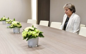 British Prime Minister Theresa May waits for the arrival of European Council President Donald Tusk prior to a bilateral meeting with European Council President Donald Tusk during an EU summit in Brussels on Friday, Oct. 20, 2017. European Union leaders gathered Friday to weigh progress in negotiations on Britain's departure from their club as they look for new ways to speed up the painfully slow moving process. (AP Photo/Geert Vanden Wijngaert, Pool)