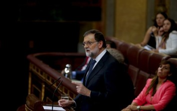 Prime Minister Mariano Rajoy speaks at the Spanish parliament in Madrid, Spain, Wednesday, Oct. 11, 2017. Rajoy said he rejected offers of mediation in the Catalonia crisis, and called for respect of Spanish law while addressing Spain's parliament a day after Catalan officials signed what they called a declaration of independence from Spain. (AP Photo/Paul White)