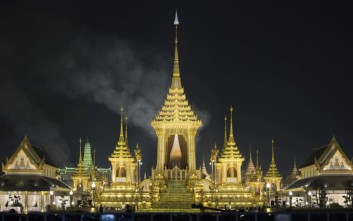 Smoke rises from the royal crematorium of Thailand's late King Bhumibol Adulyadej in Bangkok, Thailand, early Friday, Oct. 27, 2017. The funeral for Bhumibol takes place over five days and began Wednesday with his son, King Maha Vajiralongkorn, performing Buddhist merit-making rites before chanting monks and officials in immaculate white uniforms. (AP Photo/Wason Wanichakorn)