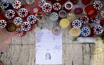 Candles, notes and paper cuttings lie next to the Love Monument in St. Julian, Malta, Tuesday Oct. 17, 2017 the day after the killing of journalist Daphne Caruana Galizia. The Maltese investigative journalist who exposed the island nation's links to offshore tax havens through the leaked Panama Papers was killed Monday when a bomb exploded in her car. (AP Photo/ Rene Rossignaud)