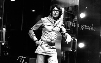 **  FILE ** In this Sept. 10, 1969 file photo, French designer Yves Saint Laurent stands outside his first London chain of Rive Gauche ready-to-wear boutique on Bond Street on opening day wearing clothing from his safari style collection in khaki cotton. Yves Saint Laurent, who reworked the rules of fashion by putting women into elegant pantsuits that came to define how modern women dressed, died Sunday evening June 1, 2008. He was 71. (AP Photo/File)