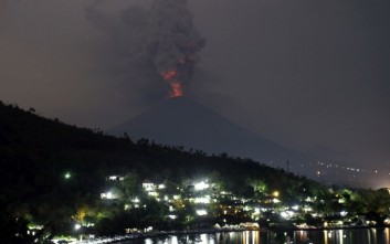 A view of the Mount Agung volcano erupting in Karangasem, Bali, Indonesia, Monday, Nov. 27, 2017. Indonesia authorities raised the alert for the rumbling volcano to highest level on Monday and closed the international airport on the tourist island of Bali stranding thousands of travelers. (AP Photo/Firdia Lisnawati)